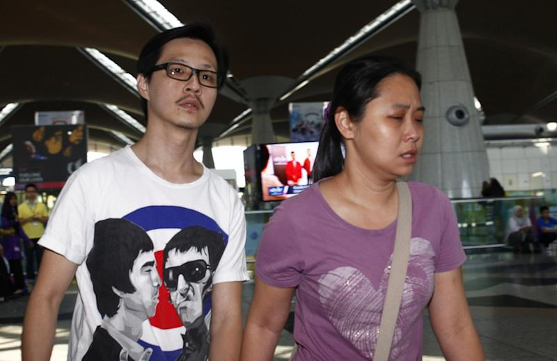 Malaysian Airlines Plane Missing: Heart-Breaking Pictures of Relatives in Distress in Beijing and Kuala Lumpur