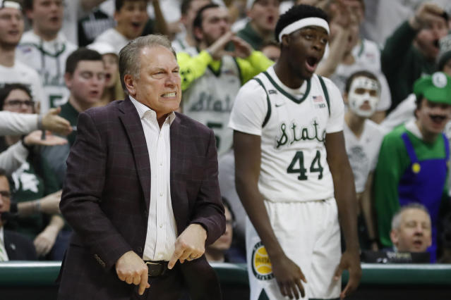 Michigan State's Tom Izzo and forward Gabe Brown (44) react after a dunk by forward Julius Marble during a game against Northwestern on Jan. 29. (AP)