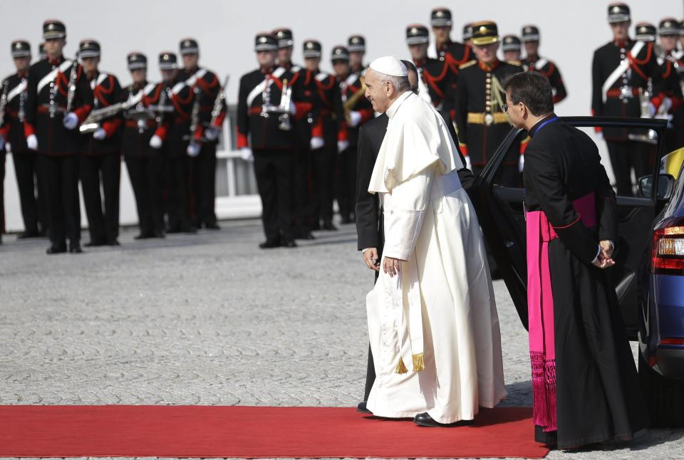 Pope Francis walks upon his arrival at the Presidential residence in Dublin, Ireland, Saturday, Aug. 25, 2018. Pope Francis is on a two-day visit to Ireland. (AP Photo/Peter Morrison)