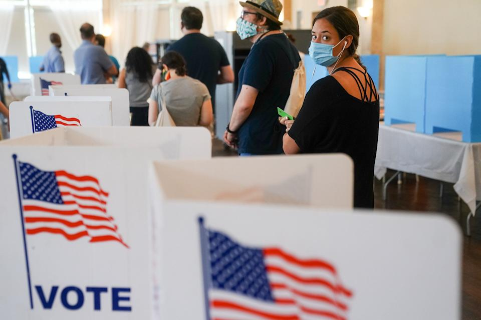 """In-person voting, too, could be compromised by Republican """"poll-watching"""" efforts that have historically been used to intimidate nonwhite voters. (Photo: Elijah Nouvelage via Getty Images)"""