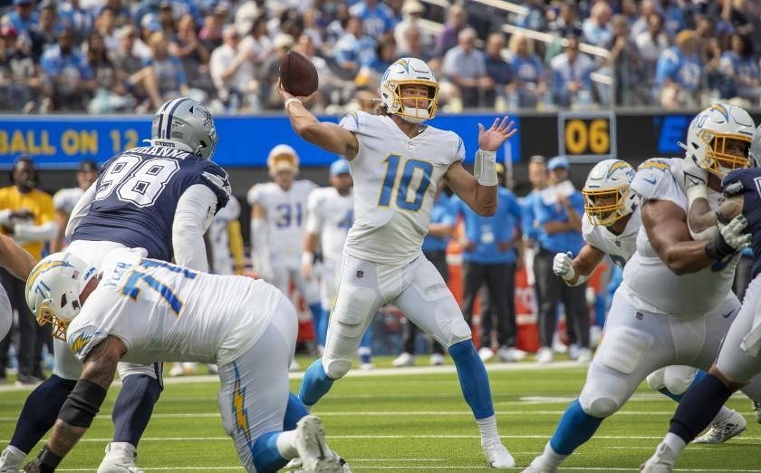 Chargers quarterback Justin Herbert passes against the Dallas Cowboys on Sept. 19, 2021.