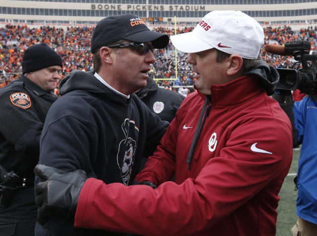 Bob Stoops and Mike Gundy had plenty of battles over the years. (AP Photo/Sue Ogrocki)