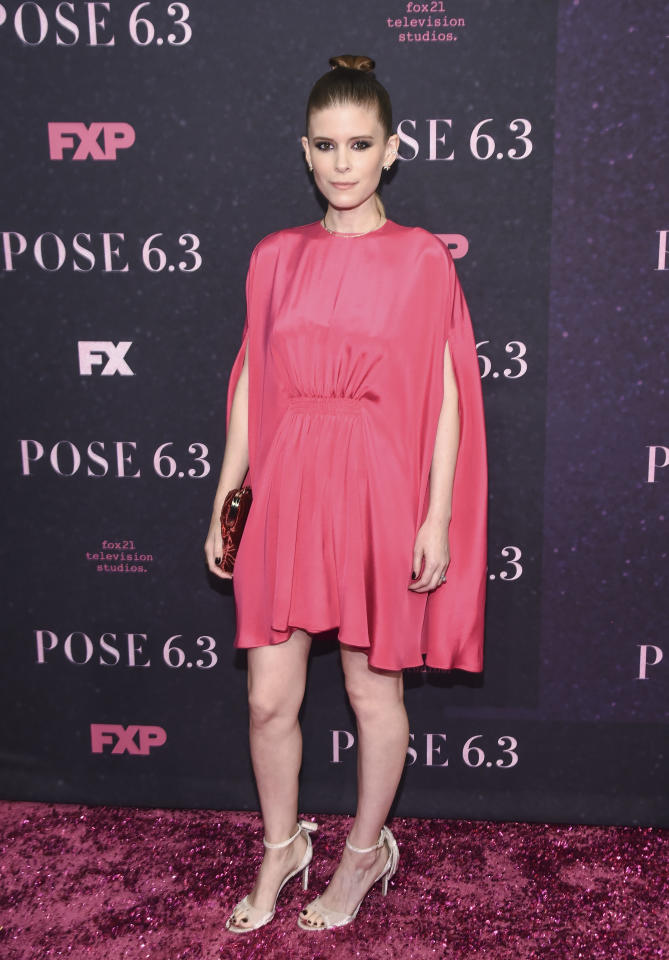 <p>Kate Mara opted for a fuschia-hued dress with cape-inspired sleeves at the New York premiere of 'Pose' on May 17. [Photo: Getty] </p>