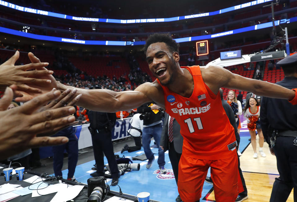 Syracuse forward Oshae Brissett (11) celebrates after defeating Michigan State in an NCAA men's college basketball tournament second-round game in Detroit, Sunday, March 18, 2018. (AP Photo/Paul Sancya)