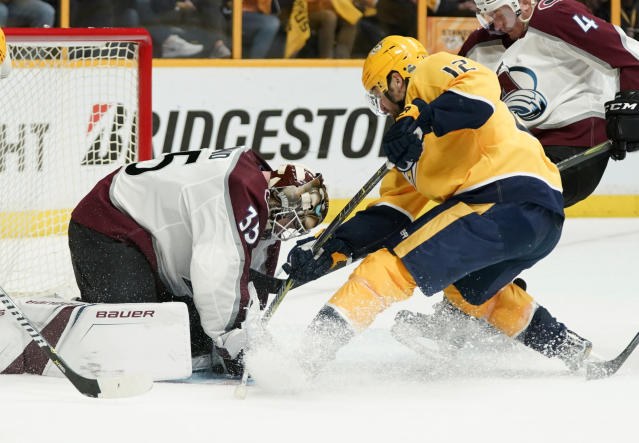 Colorado Avalanche goaltender Andrew Hammond (35) makes the save as Nashville Predators center Mike Fisher (12) drives to the net during the second period in Game 5 of an NHL hockey first-round playoff series Friday, April 20, 2018, in Nashville, Tenn. (AP Photo/Sanford Myers)