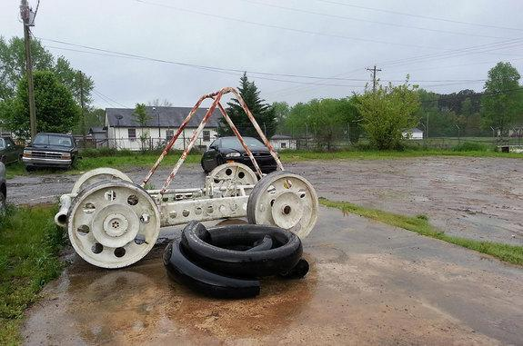 A thought-lost-but-now-found NASA moon buggy as it appears today in an Alabama junkyard.