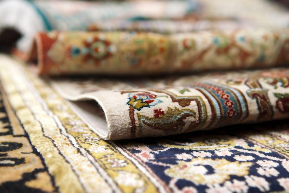 "<p>They're not only beautiful, but handmade antique Persian rugs can regularly sell for a few hundred dollars on up into the millions. The most expensive ever auctioned was a rug from the 17th century, which went for a cool <a href=""https://www.nola.com/entertainment_life/home_garden/article_1b00ad9d-7784-522f-a56a-9bd7455e3793.html"" rel=""nofollow noopener"" target=""_blank"" data-ylk=""slk:$33 million in 2013"" class=""link rapid-noclick-resp"">$33 million in 2013</a>.</p>"