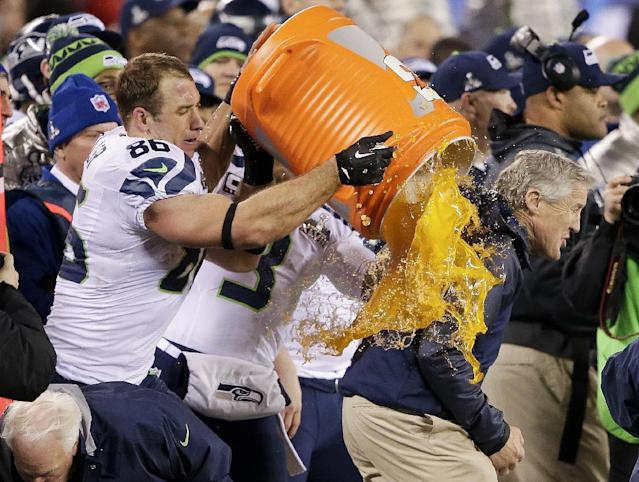 Seattle Seahawks' Zach Miller dumps Gatorade on Seattle Seahawks head coach Pete Carroll during the second half of the NFL Super Bowl XLVIII football game Sunday, Feb. 2, 2014, in East Rutherford, N.J. The Seahawks won 43-8. (AP Photo/Gregory Bull)