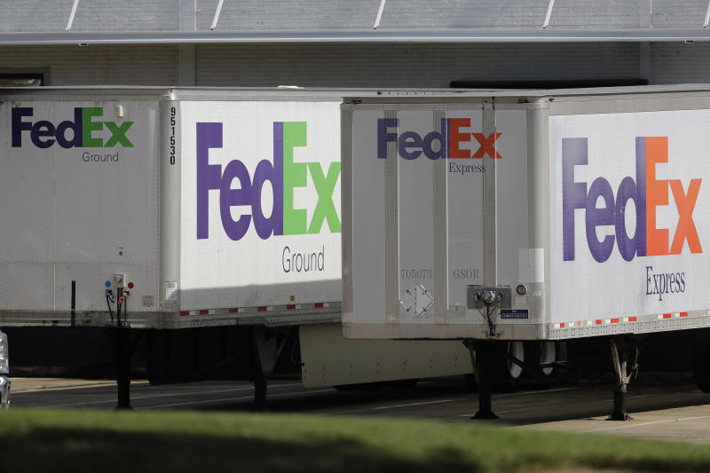 FedEx trailers are shown at a loading dock in Greensboro, N.C., Tuesday, June 25, 2019. FedEx is suing the United States government over export rules it says are virtually impossible to follow because it handles millions of packages a day. (AP Photo/Chuck Burton)