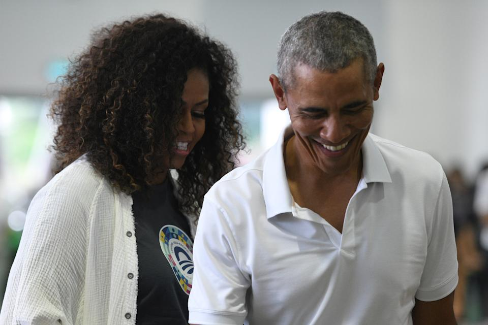 Michelle Obama and Barack Obama appear in Kuala Lumpur, Malaysia. (Credit: Getty Images)