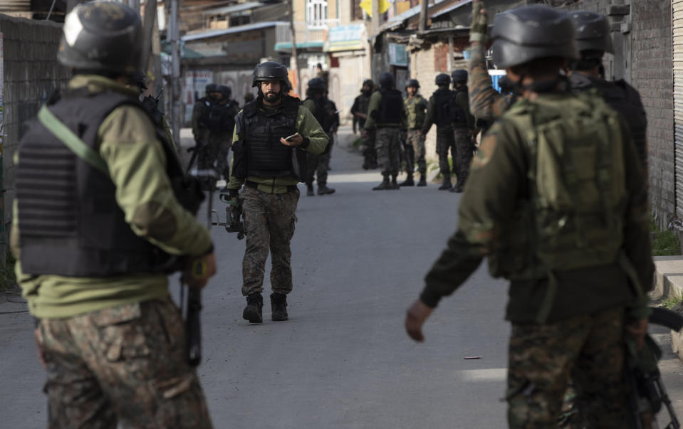 Indian soldiers arrive at the site of an attack on the outskirts of Srinagar, Indian controlled Kashmir, Thursday, March 25, 2021. Rebels fighting against Indian rule in disputed Kashmir Thursday attacked a paramilitary patrol, killing two soldiers and injuring two others, an official said. (AP Photo/Mukhtar Khan)