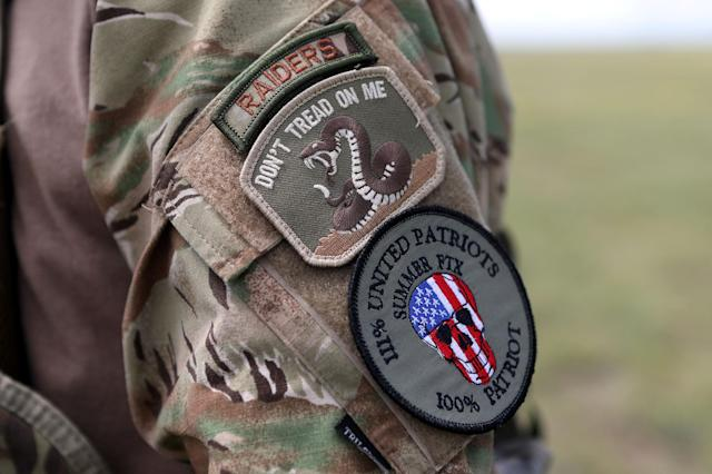 <p>Many members of self-described patriot groups and militias wore patches during III% United Patriots' Field Training Exercise outside Fountain, Colo., July 29, 2017. (Photo: Jim Urquhart/Reuters) </p>