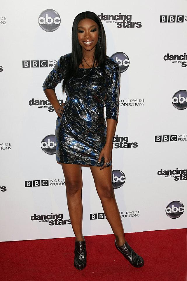 "Meanwhile in Hollywood, ""Dancing With the Stars"" diva Brandy attended the show's 200th episode party at Boulevard 3 in a black-and-blue sequined mini, fashion-forward booties, and her signature smile. Tonya Wise/London Ent/<a href=""http://www.splashnewsonline.com"" target=""new"">Splash News</a> - November 1, 2010"