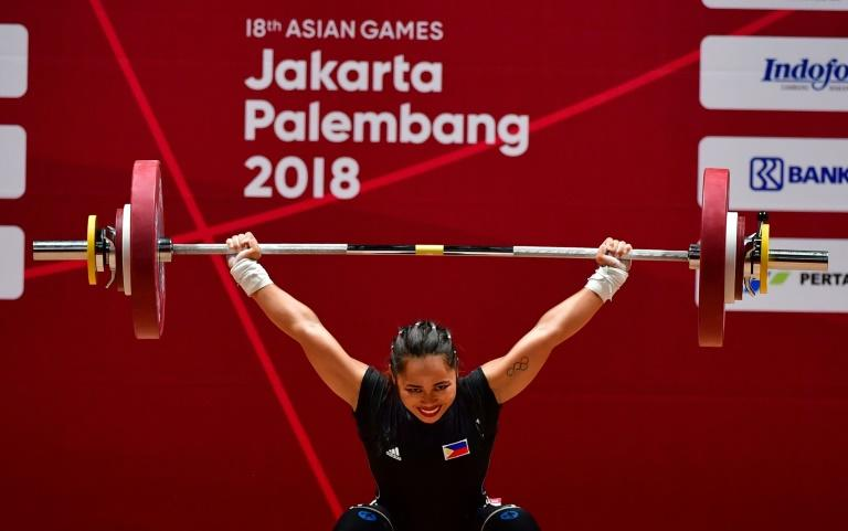 Hidilyn Diaz of Philippines competes in the women's 53kg weightlifting event during the 2018 Asian Games in Jakarta on August 21, 2018