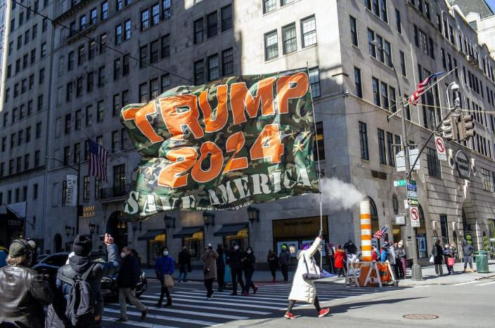 "<span class=""caption"">Supporters of former President Trump gather outside of Trump Tower during a rare visit Trump made to his New York offices, March 8, 2021.</span> <span class=""attribution""><a class=""link rapid-noclick-resp"" href=""https://www.gettyimages.com/detail/news-photo/supporters-of-former-president-trump-gather-outside-of-news-photo/1306020725?adppopup=true"" rel=""nofollow noopener"" target=""_blank"" data-ylk=""slk:Andrew Lichtenstein/Corbis via Getty Images"">Andrew Lichtenstein/Corbis via Getty Images</a></span>"