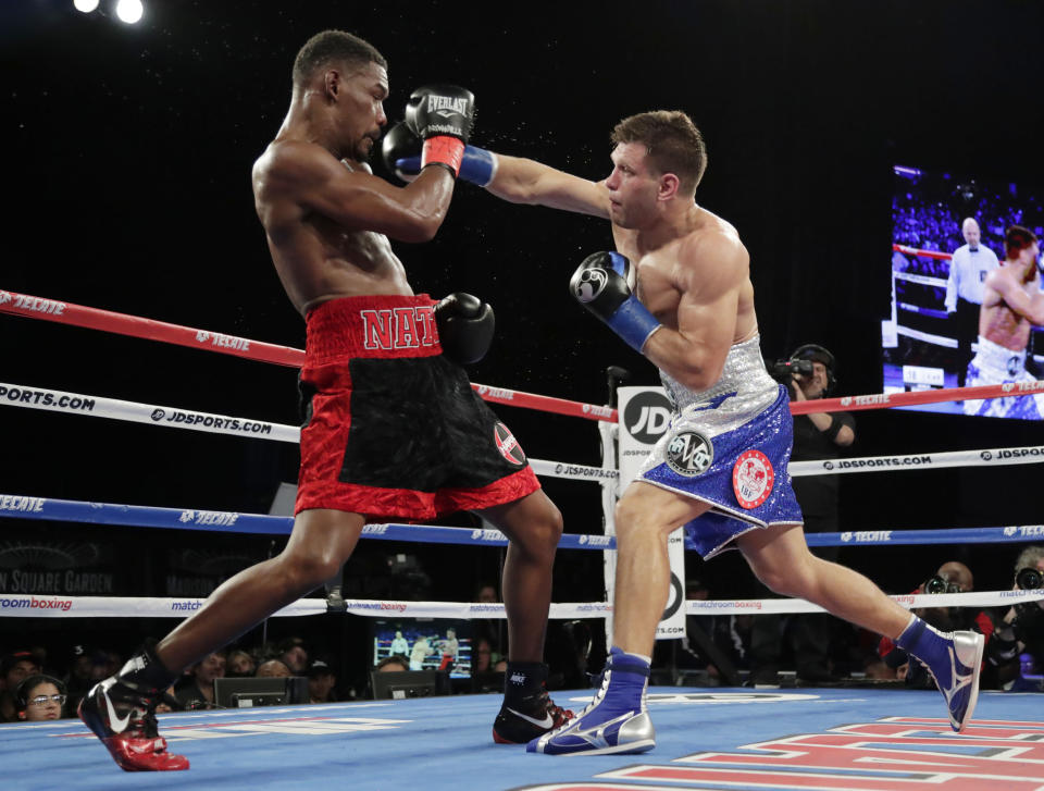 Ukraine's Sergiy Derevyanchenko, right, punches Daniel Jacobs during the fifth round of a IBF middleweight championship boxing match Saturday, Oct. 27, 2018, in New York. Jacobs won the fight. (AP Photo/Frank Franklin II)