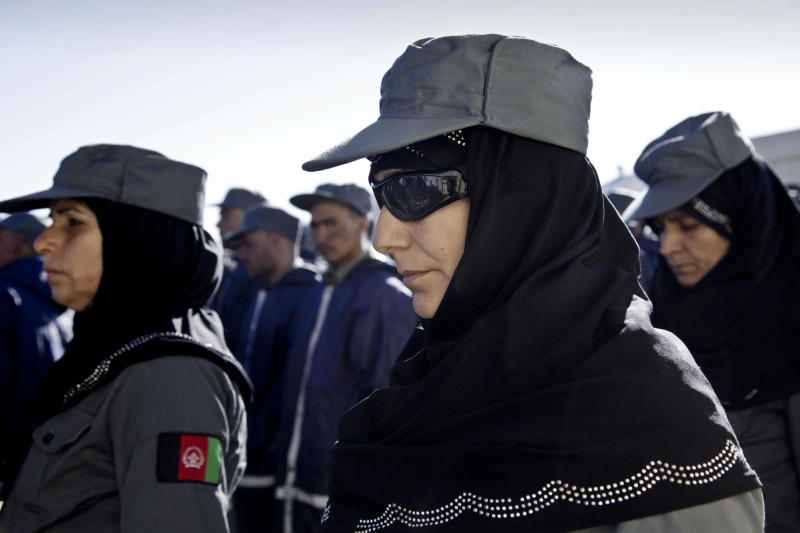 FILE - In this Dec. 20, 2012 file photo, Afghan policewomen attend their graduation ceremony in Herat, west of Kabul, Afghanistan. Human Rights Watch urged the Afghan government on Thursday to force police stations to build restrooms for female officers to protect them from sexual harassment. The group said only a handful of provincial police stations have separate, safe and lockable toilets or changing rooms for women officers, leaving them at risk in a nation where some have reportedly been raped by male colleagues. (AP Photo/Hoshang Hashimi, File)