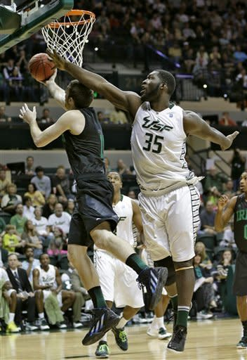 South Florida center Jordan Omogbehin (35) blocks a shot by Notre Dame center Garrick Sherman (11) during the first half of an NCAA college basketball game Saturday, Jan. 26, 2013, in Tampa, Fla. (AP Photo/Chris O'Meara)