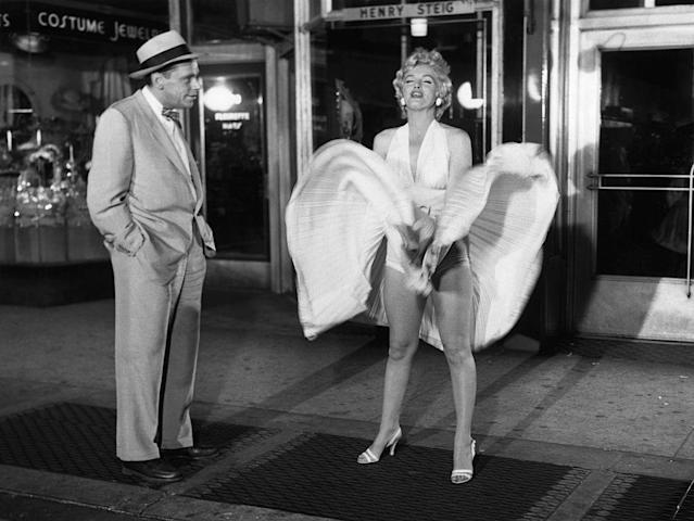 """Tom Ewell and Marilyn Monroe in the famous subway scene from """"The Seven Year Itch."""" (Photo: Bettman/Getty Images)"""