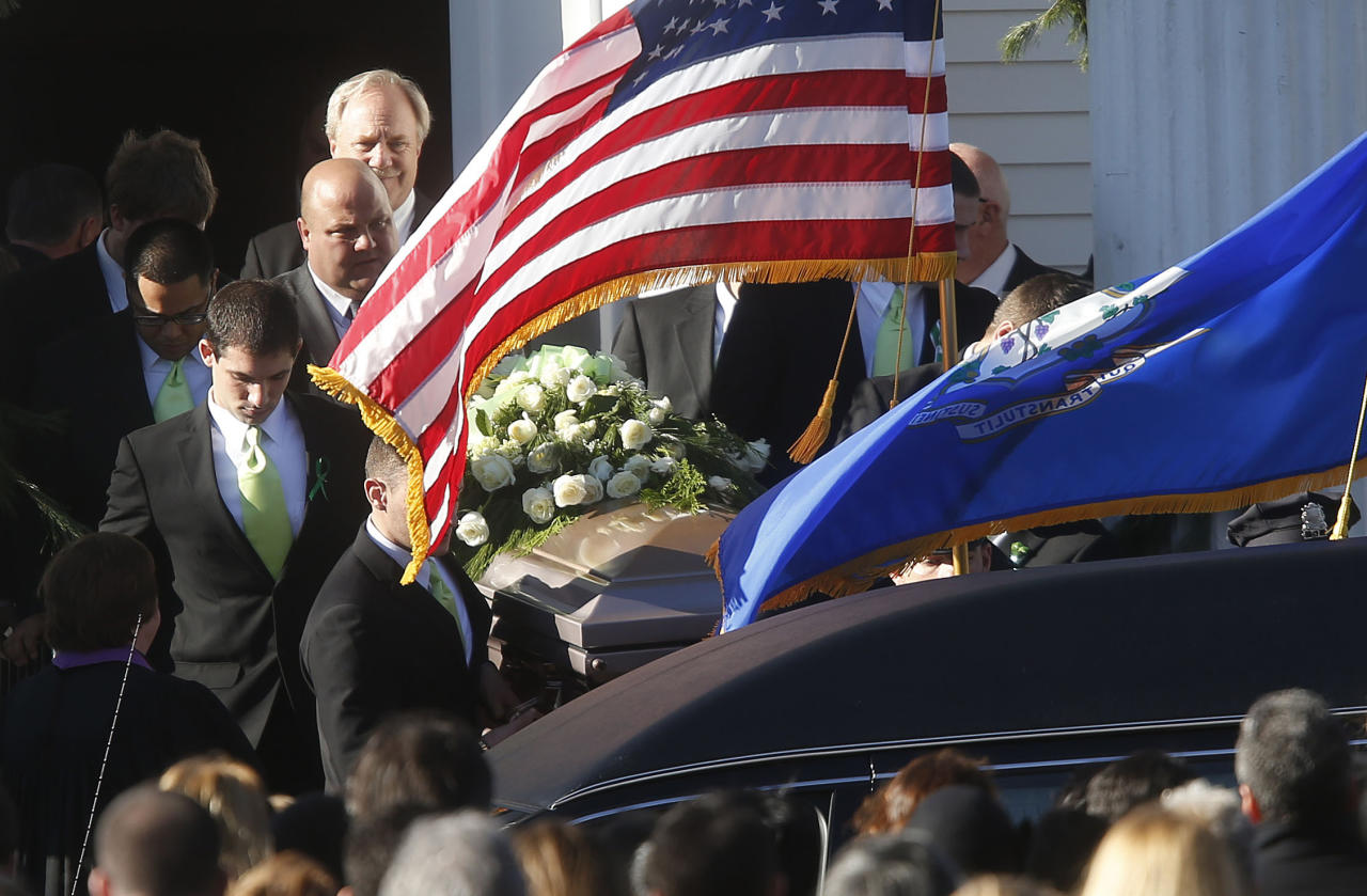 A coffin bearing the body of Victoria Soto is carried out of Lordship Community Church after her funeral service, Wednesday, Dec. 19, 2012, in Stratford, Conn. Soto was killed when Adam Lanza walked into Sandy Hook Elementary School in Newtown, Conn., Dec. 14, and opened fire, killing 26 people, including 20 children, before killing himself.(AP Photo/Jason DeCrow)