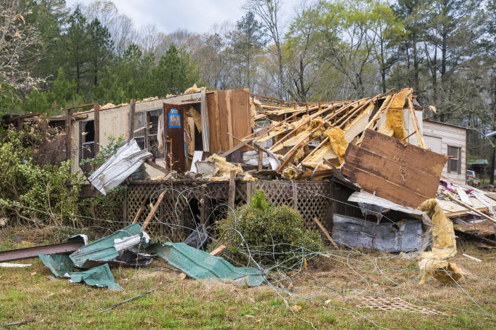 Damage to Bobbi Harris' property on Old Greensboro Road is seen, Wednesday, March 17, 2021, in Moundville, Ala., after severe weather came through the area. No one was inside at the time. (AP Photo/Vasha Hunt)
