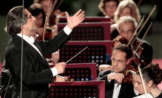 Leader of the pack: Riccardo Muti conducts his orchestra during a concert at the Vatican in May.
