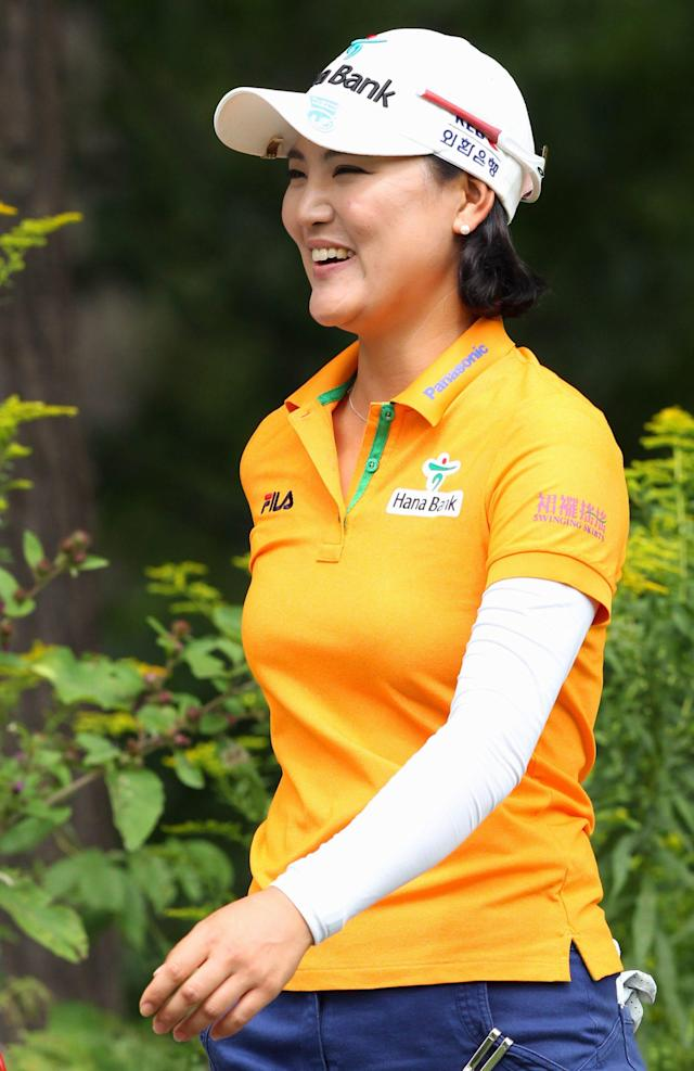 So Yeon Ryu, of South Korea, smiles as she walks to the eighth hole during final-round play at the Canadian Pacific Women's Open golf tournament in London, Ontario, Sunday, Aug. 24, 2014. (AP Photo/The Canadian Press, Dave Chidley)