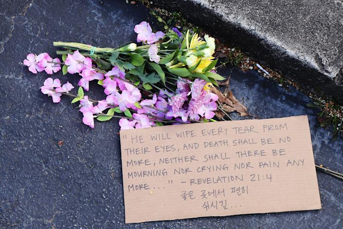 Image: Flowers left in front of Gold Spa in Atlanta (Hanna Park)