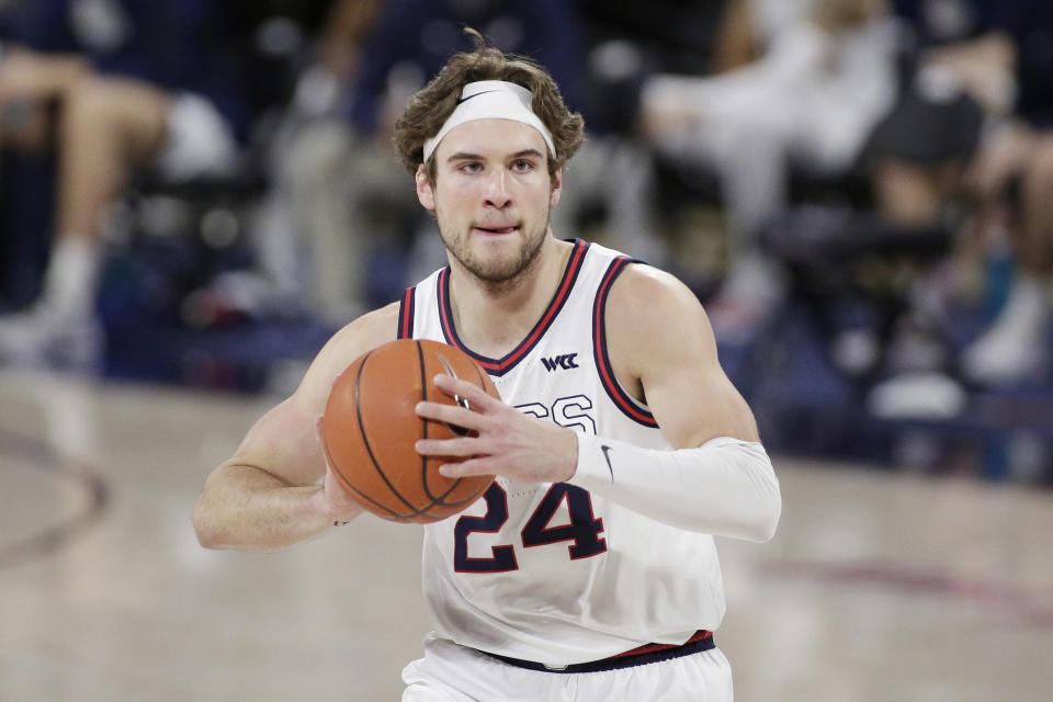 FILE - Gonzaga forward Corey Kispert prepares to pass the ball during the first half of an NCAA college basketball game against Loyola Marymount in Spokane, Wash., in this Saturday, Feb. 27, 2021, file photo. Kispert has made The Associated Press All-America first team, announced Tuesday, March 16, 2021. (AP Photo/Young Kwak, File)