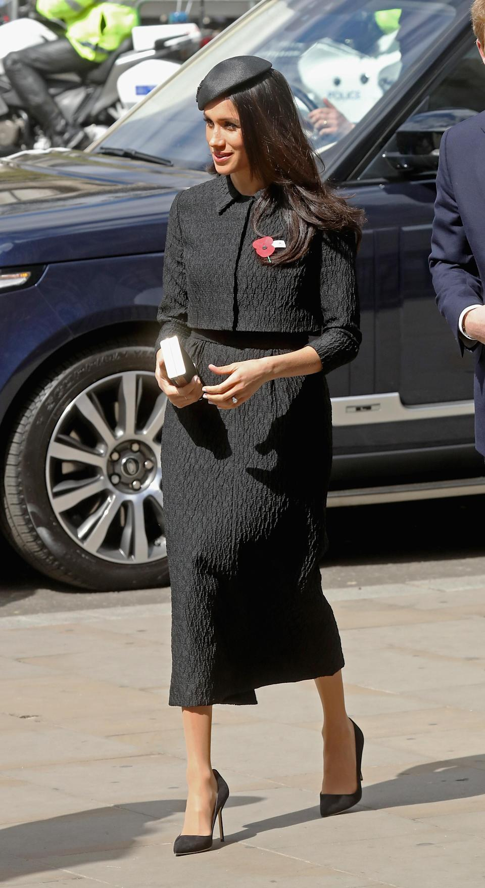 Meghan Markle wore a midi skirt and a cropped jacket by Emilia Wickstead at the Anzac Day Service of Commemoration and Thanksgiving [Photo: Getty]