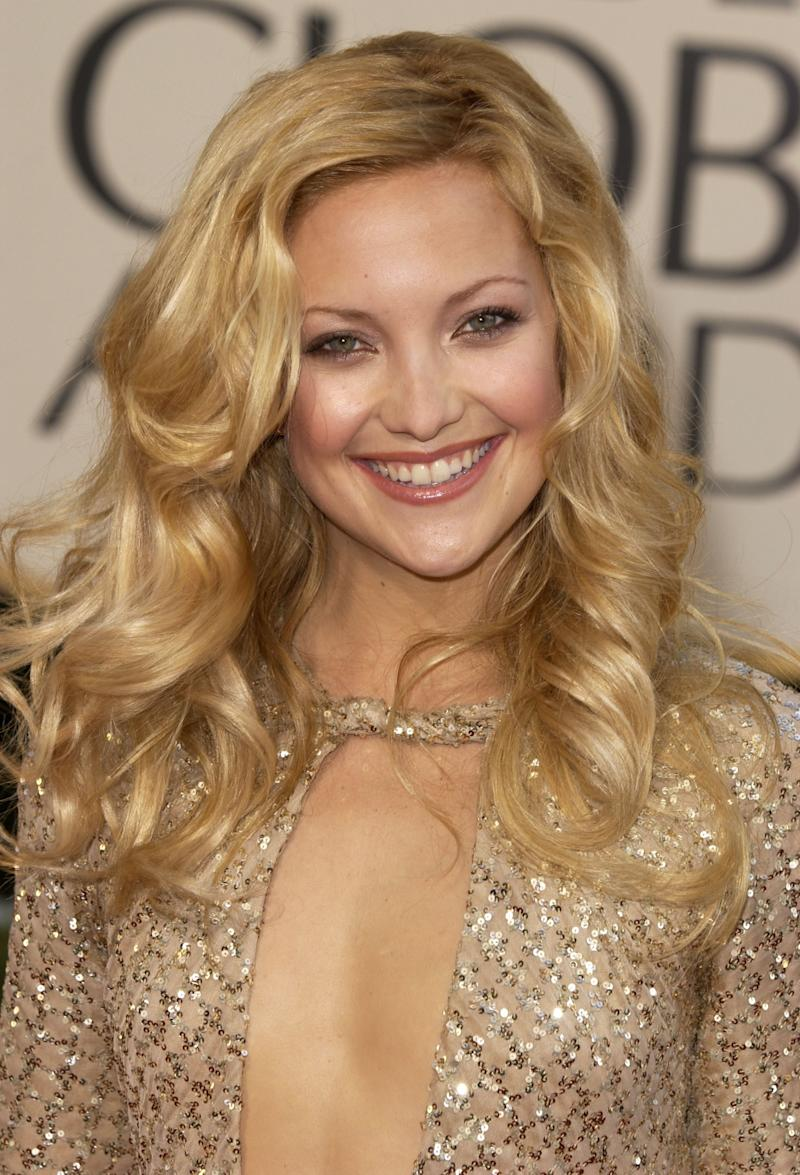 Radiating at the 2002 Golden Globe Awards, Hudson wears her golden blonde locks in voluminous curls with a hint of blush on the cheeks.