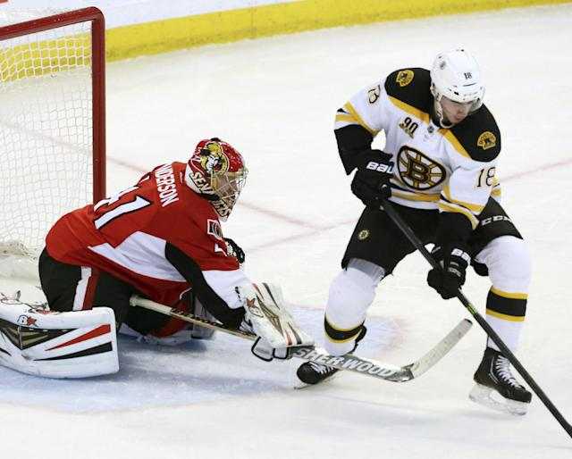Ottawa Senators goaltender Craig Anderson (41) draws a tripping penalty on Boston Bruins' Reilly Smith (18) during the second period of an NHL hockey game in Ottawa, Ontario on Saturday, Dec. 28, 2013. (AP Photo/The Canadian Press, Fred Chartrand)