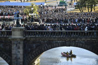 People head to the venue for Japan's Emperor Akihito's public appearance with his family members at Imperial Palace in Tokyo Wednesday, Jan. 2, 2019. Akihito waved Wednesday to throngs of well-wishers eager to see the final New Year's appearance in his reign. (Yu Nakajima/Kyodo News via AP)