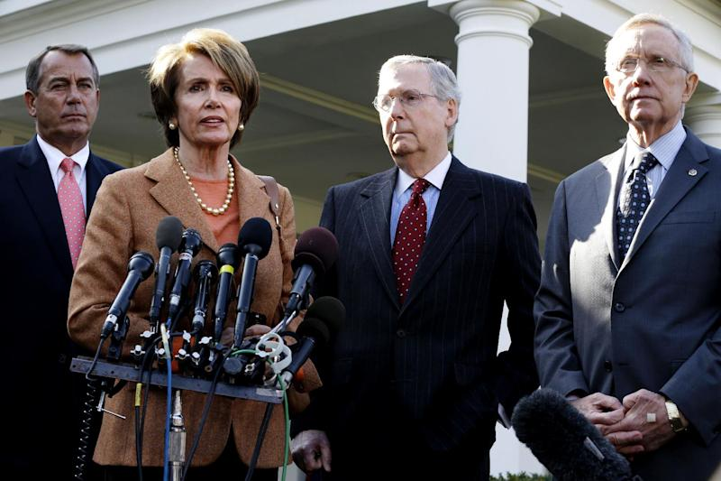 FILE - In this Nov. 16, 2012, file photo House Minority Leader, Democrat Nancy Pelosi of California, second from left, House Speaker, Republican John Boehner of Ohio, Senate Minority Leader, Republican Mitch McConnell of Kentucky, and Senate Majority Leader, Democrat Harry Reid of Nevada, take turns speaking to reporters outside the White House in Washington after their meeting with President Barack Obama. Cs. (AP Photo/Jacquelyn Martin, File)
