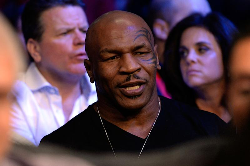 LAS VEGAS, NV - OCTOBER 12: Former boxer Mike Tyson sits in the stands as he watches Orlando Cruz fight Orlando Salido (both not pictured) during their WBO featherweight championship bout at the Thomas & Mack Center on October 12, 2013 in Las Vegas, Nevada. (Photo by Jeff Bottari/Getty Images)