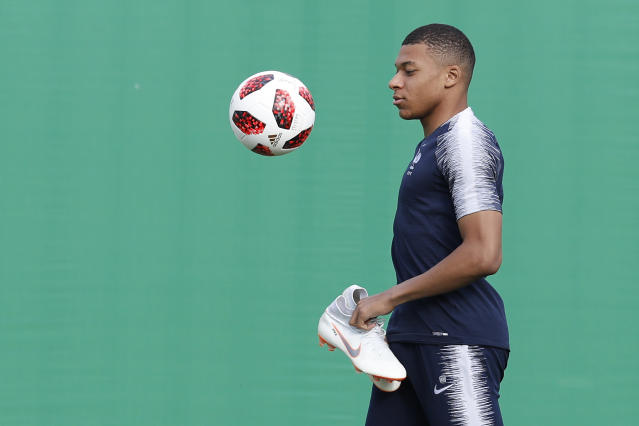 France's Kylian Mbappe arrives on the pitch at the start of the official training session at the eve of the final against Croatia at the 2018 soccer World Cup in Moscow, Russia, Saturday, July 14, 2018. (AP Photo/David Vincent)