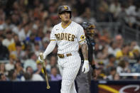 San Diego Padres' Manny Machado reacts after striking out with the bases loaded during the fifth inning of a baseball game against the San Francisco Giants, Wednesday, Sept. 22, 2021, in San Diego. (AP Photo/Gregory Bull)
