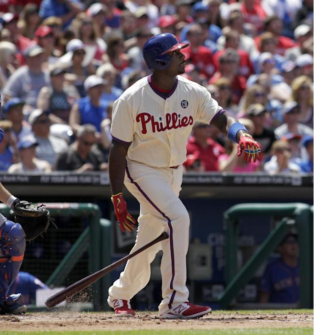 Philadelphia Phillies' Ryan Howard watches his two-run home run against the New York Mets in the fourth inning of a baseball game, Sunday, June 1, 2014, in Philadelphia. (AP Photo/H. Rumph Jr)