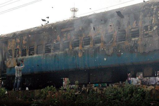 At least 32 people were killed Monday when a fire ripped through a coach on an express train as it carried sleeping passengers to the southern Indian city of Chennai