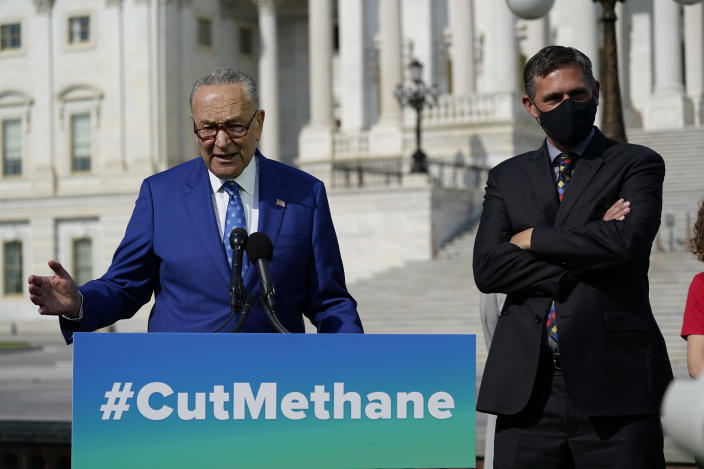 Senate Majority Leader Chuck Schumer, D-N.Y., joined by Sen. Martin Heinrich, D-N.M., right, talks about legislation to re-impose critical regulations to reduce methane pollution from oil and gas wells, at the Capitol in Washington, Wednesday, April 28, 2021. (AP Photo/J. Scott Applewhite)