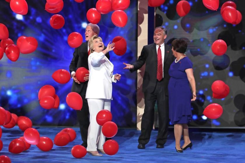 Democratic presidential candidate Hillary Clinton stands with her husband former President Bill Clinton on stage with Vice President nominee Tim Kaine and his wife Anne Holton at the end of the fourth day of the Democratic National Convention.