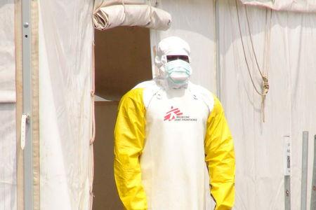 A Doctors Without Borders health worker stands in an Ebola virus treatment center in Conakry, Guinea, November 17, 2015.   REUTERS/Saliou Samb