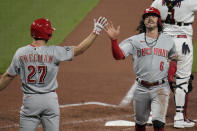 Cincinnati Reds' Jonathan India (6) is congratulated by teammate Mike Freeman (27) after scoring during the sixth inning of a baseball game against the St. Louis Cardinals Friday, June 4, 2021, in St. Louis. (AP Photo/Jeff Roberson)