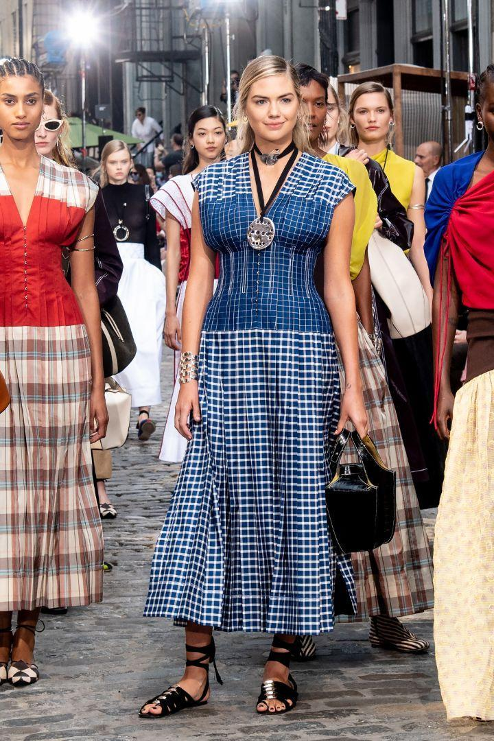 Kate Upton walks the runway for the Tory Burch Spring / Summer 22 show during New York Fashion Week on September 12.  - Credit: RCF / MEGA