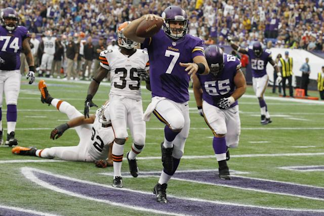 Minnesota Vikings quarterback Christian Ponder (7) celebrates after scoring on a 6-yard touchdown run during the first half of an NFL football game against the Cleveland Browns Sunday, Sept. 22, 2013, in Minneapolis. (AP Photo/Ann Heisenfelt)