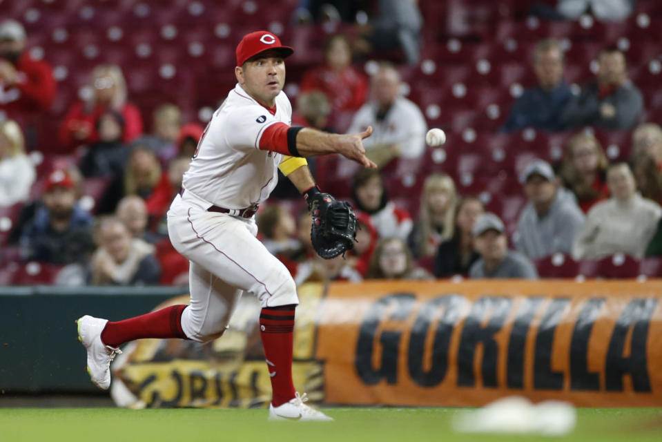 Cincinnati Reds' Joey Votto makes a throw to first base against the Washington Nationals during the eighth inning of a baseball game Thursday, Sept. 23, 2021, in Cincinnati. The Nationals beat the Reds 3-2. (AP Photo/Jay LaPrete)