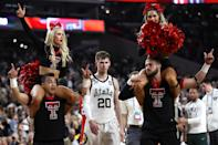 Matt McQuaid #20 of the Michigan State Spartans walks past Texas Tech Red Raiders cheerleaders after being defeated by the Red Raiders 61-51 during the 2019 NCAA Final Four semifinal at U.S. Bank Stadium on April 6, 2019 in Minneapolis, Minnesota. (Photo by Streeter Lecka/Getty Images)