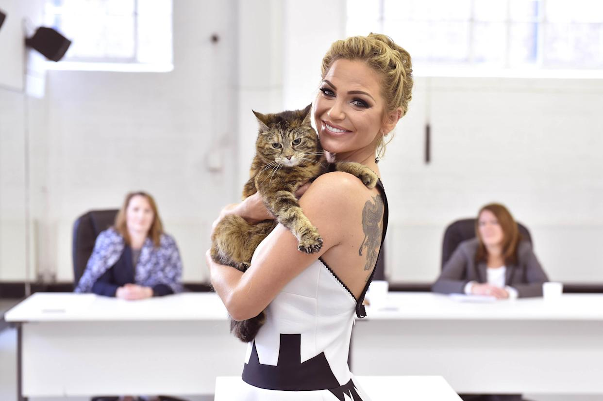 File photo dated 30/04/2015 of Sarah Harding holds Sydney, a domestic short haired cat from Guildford, during the auditions to find Britainv�s Happiest Cat and the new face of O2 Refresh, the network's Pay Monthly tariff, at the Pineapple Studios in Covent Garden, London. The Girls Aloud star has died at the age of 39, her mother has said in a post on Instagram. Issue date: Sunday September 5, 2021.