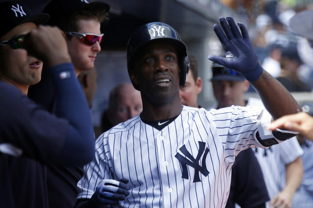 New York Yankees' Andrew McCutchen celebrates his solo home run with teammates during the first inning of a baseball game against the Toronto Blue Jays on Sunday, Sept. 16, 2018, in New York. (AP Photo/Adam Hunger)