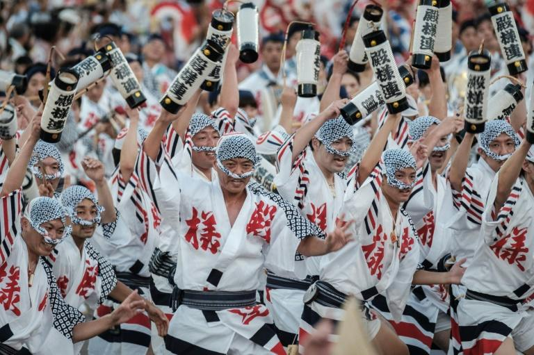 """Participants of a """"load team"""" perform during the Awa Odori festival in Tokushima on August 12, 2017 - the four-day dance festival attracts more than 1.2 million people annually"""